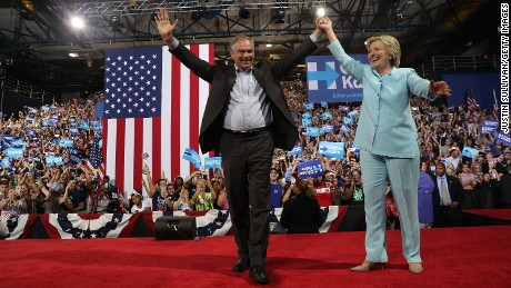 Democratic presidential candidate former Secretary of State Hillary Clinton and Democratic vice presidential candidate U.S. Senator Tim Kaine greet supporters during a campaign rally at Florida International University Panther Arena on Saturday, July 23 in Miami, Florida.