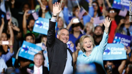 Democratic presidential candidate Hillary Clinton arrives with Sen. Tim Kaine, D-Va., at a rally at Florida International University Panther Arena in Miami, Saturday, July 23, 2016. Clinton has chosen Kaine to be her running mate. (AP Photo/Mary Altaffer)