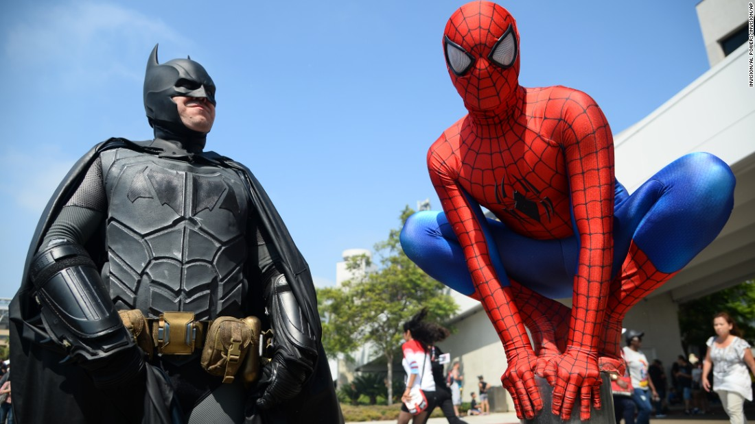 Dorian Black as Batman and Kyle Blankenfield as Spiderman pose for the camera.