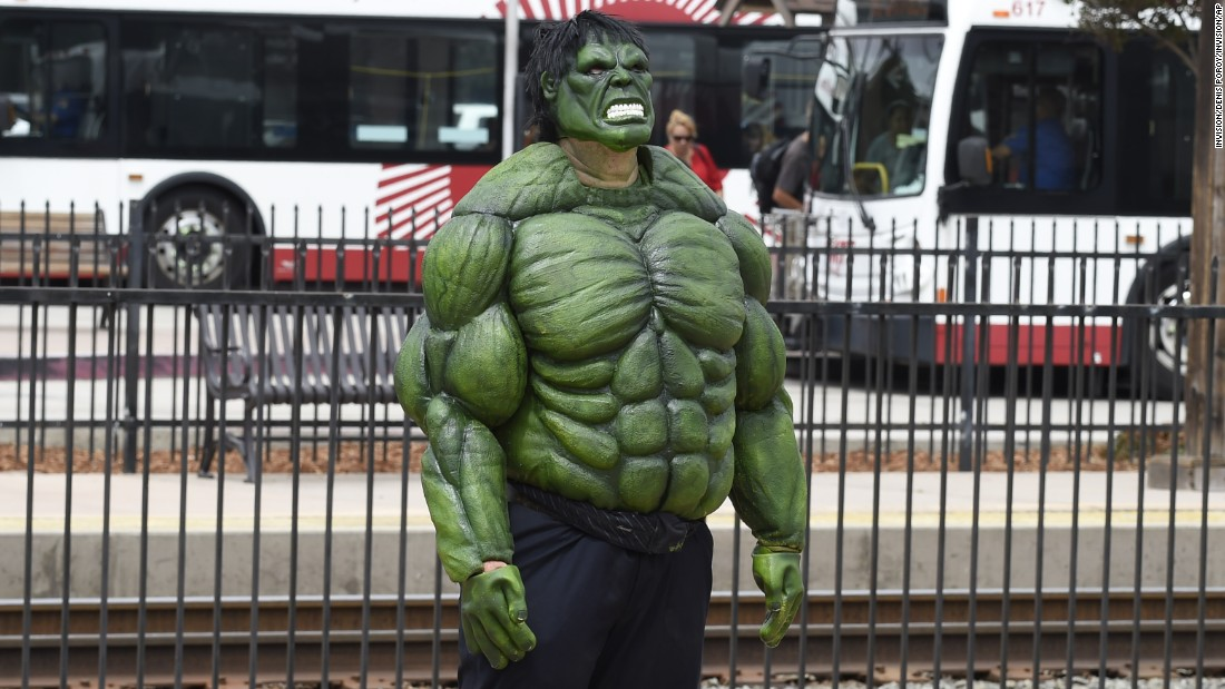 Todd Christian, dressed as the Incredible Hulk, waits for the San Diego Trolley.