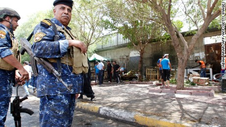 Iraqi security forces stand guard at the site of Sunday's blast.