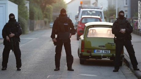 Special police forces secure a street near the house occupied by a Syrian man who detonated a  bomb outside a music festival in Ansbach, Sunday.