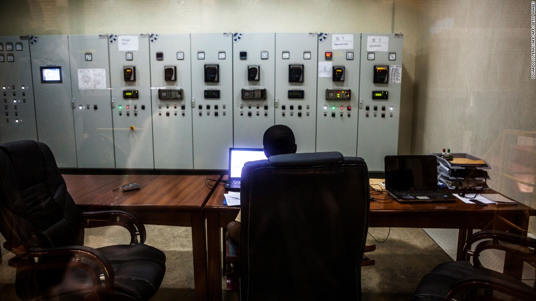 A technician works on a computer at the control room of the Matebe dam.