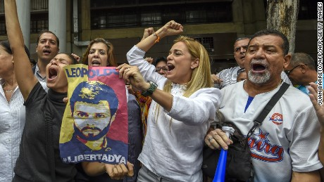 Lilian Tintori (C), wife of Venezuela's jailed opposition leader Leopoldo Lopez, protests outside the court in Caracas on June 20, 2016.  The hearing of Lopez was postponed again after the designated judge did not appear citing health problems. / AFP / JUAN BARRETO        (Photo credit should read JUAN BARRETO/AFP/Getty Images)