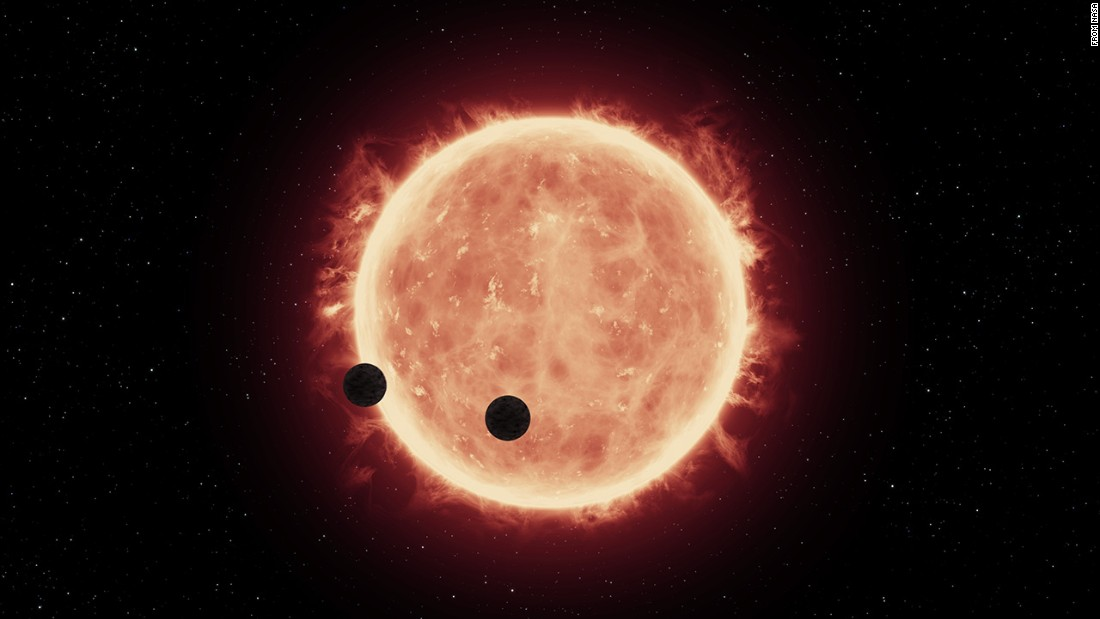An artist's rendering shows Earth-sized exoplanets TRAPPIST-1b and 1c in a rare double transit event as they pass in front of their ultracool red dwarf star, which allowed Hubble to take a peek at at their atmospheres.