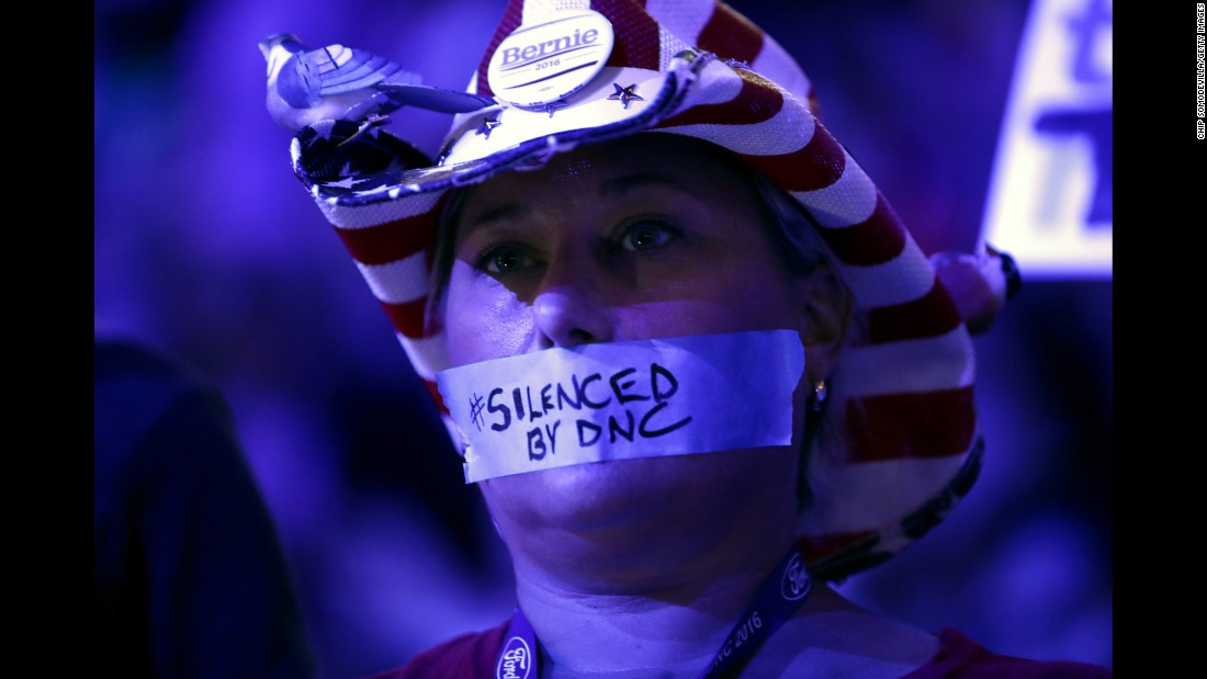 "Tape on a delegate's mouth makes a statement Monday about the Democratic National Committee. Recently leaked committee emails <a href=""http://www.cnn.com/2016/07/22/politics/dnc-wikileaks-emails/index.html"" target=""_blank"">appeared to show favoritism toward Clinton</a> in the primary race, and many Sanders supporters entered the convention upset. The controversy has caused Debbie Wasserman Schultz to step down as the committee's chairwoman at the end of the convention."