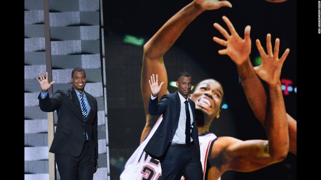 Former pro basketball players Jason Collins, left, and Jarron Collins wave to the crowd. Jason Collins, the first openly gay player in the NBA, said he told the Clintons about his sexual orientation before coming out publicly.