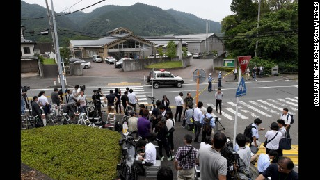 Journalists gather at the main gate of the Tsukui Yamayuri-en care center