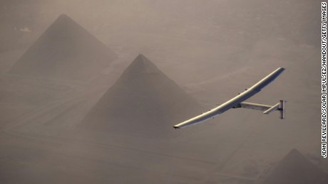 GIZA, EYGPT - JULY 13:  In this handout image supplied by Jean Revillard, Solar Impulse 2, the solar powered plane, piloted by Swiss pioneer Andre Borschberg is seen during the fly over the pyramids prior to landing in Cairo on 13 July, 2016 in Giza, Eygpt.  The 16th leg of the round-the-world-trip from Seville in Spain covered a disdance of 3700 kilometers and took almost 49 hours. The Solar Impulse 2 is equipped with 17,000 solar cells, has a wingspan of 72 metres, and yet weighs just over 2 tonnes. (Photo by Jean Revillard/Solar Impulse2 via Getty Images)