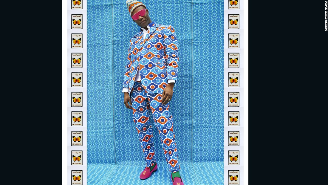 "Fashion designer Joe Casely-Hayford wears a suit made of canopy fabric, commonly used for little shops in Moroccan medinas. ""Joe is a famous British fashion designer so it fitted very well in the context of the exhibition,"" says Hajjaj. Although they appear as studio portraits, most of Hassan Hajjaj's images are taken on the streets."