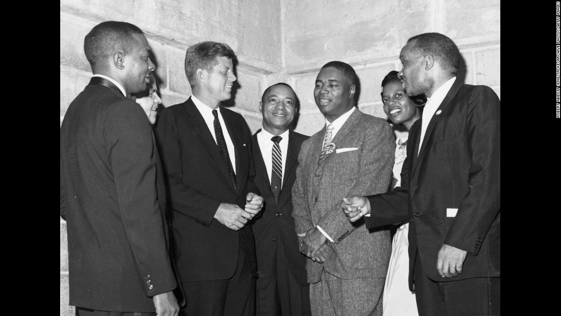 Kennedy meets with a group of delegates at the convention. Kennedy became the youngest President ever elected in November, and the African-American vote went heavily for Kennedy over Richard M. Nixon.