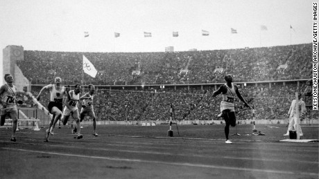 Owens wins the 100 metres at the 1936 Olympics in Berlin