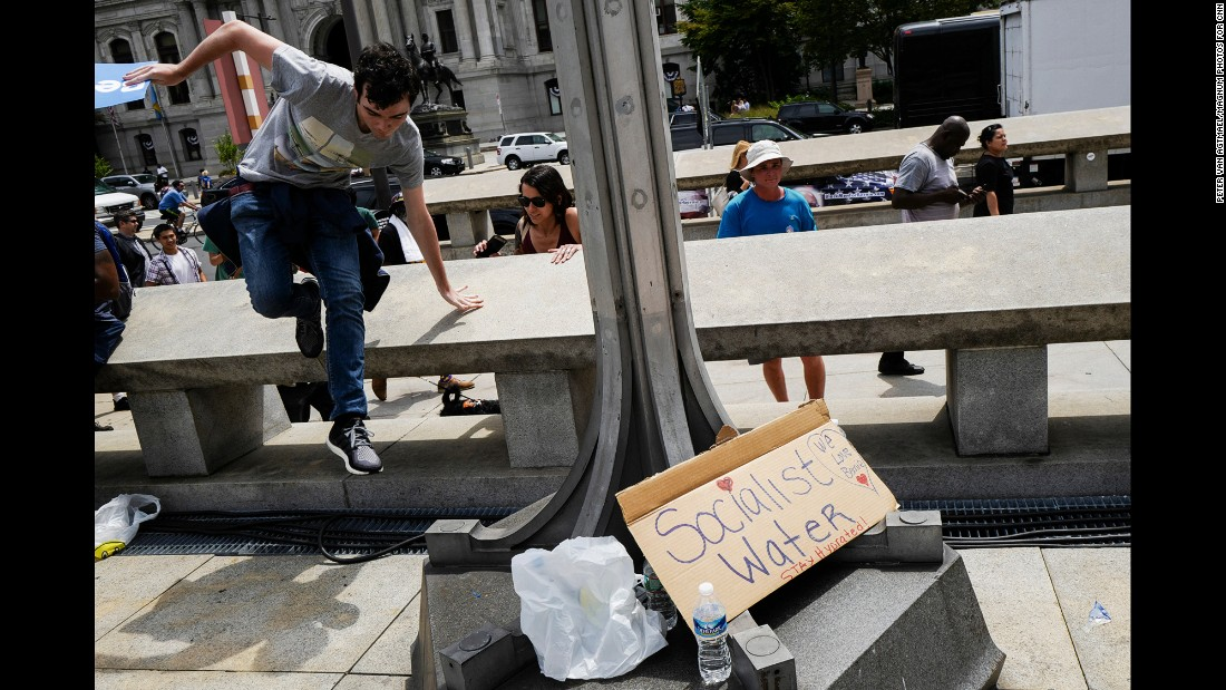 Free water is offered on the street. Temperatures in the city hit triple digits on Monday -- with a heat index of 117. A heavy thunderstorm followed, causing protesters to huddle under a highway overpass to stay dry.