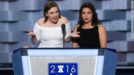 Actresses America Fererra (R) and Lena Dunham (L) arrive onm stage to address the second day of the Democratic National Convention at the Wells Fargo Center, July 26, 2016 in Philadelphia, Pennsylvania.      / AFP / SAUL LOEB        (Photo credit should read SAUL LOEB/AFP/Getty Images)