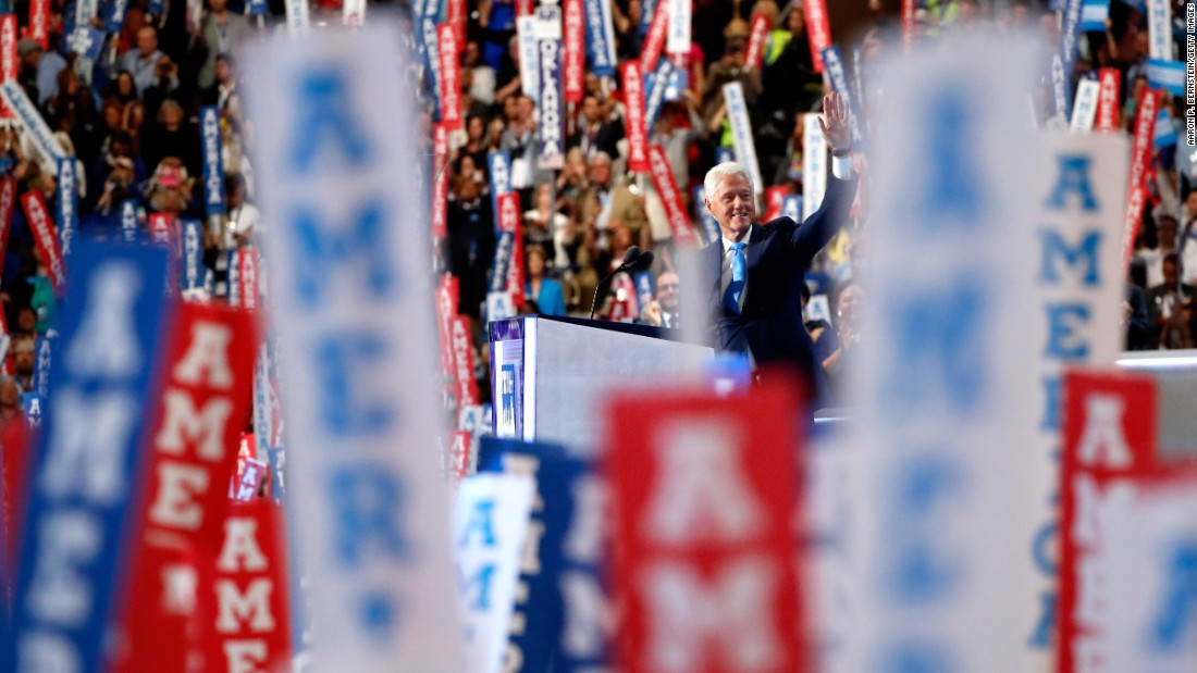 Former U.S. President Bill Clinton waves to the crowd before giving a speech on Tuesday.