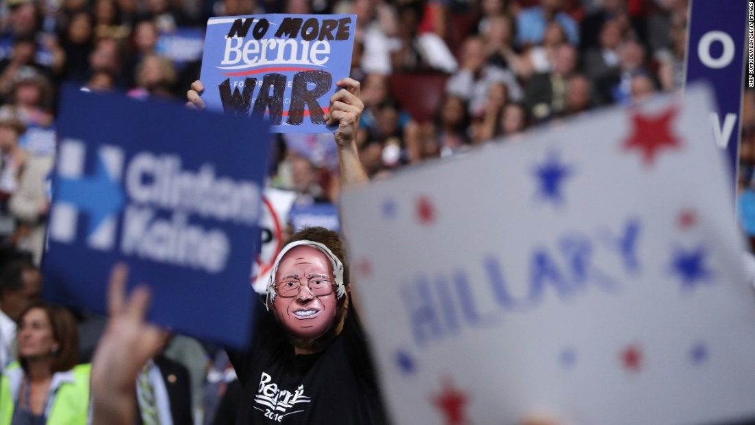 A delegate wears a Bernie Sanders mask on Wednesday. Sanders finished second to Clinton in the presidential primaries.