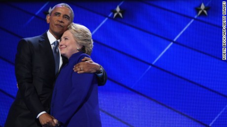 Obama hugs Clinton during the third night of the Democratic National Convention in Philadelphia, Pennsylvania.