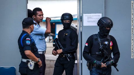 CILACAP, CENTRAL JAVA, INDONESIA - JULY 27:  Indonesian police walk as guard at Wijayapura port, which is the entrance gate to Nusakambangan prison as Indonesia prepare for third round of drug executions on July 27, 2016 in Cilacap, Central Java, Indonesia. According to reports, Indonesia is likely to resume executions of 14 prisoners on death row this week. Fourteen prisoners, including inmates from Nigeria, Pakistan, India, South Africa, and four Indonesians, have been moved to isolation holding cells at Nusa Kambangan, off Central Java.  (Photo by Ulet Ifansasti/Getty Images)