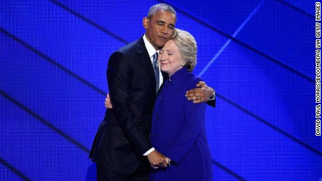 U.S. President Barack Obama hugs Hillary Clinton, 2016 Democratic presidential nominee, on stage during the Democratic National Convention (DNC) in Philadelphia, Pennsylvania, U.S., on Wednesday, July 27, 2016. With the historic nomination for the first woman to run as the presidential candidate of a major U.S. political party, Democrats gathered in Philadelphia hoped they had turned a corner on Tuesday. Photographer: David Paul Morris/Bloomberg via Getty Images