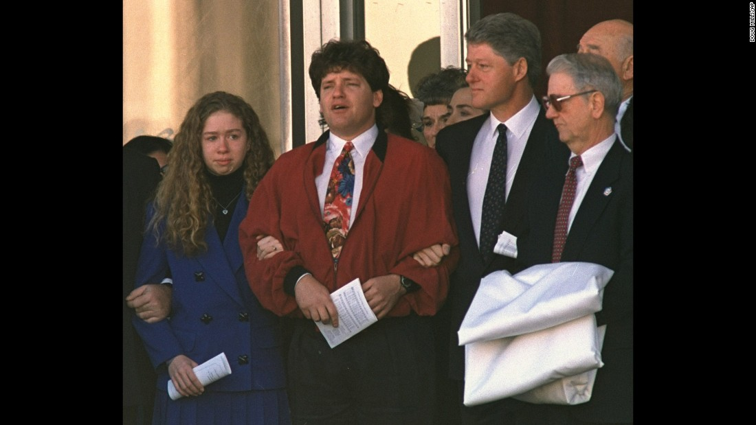 Chelsea holds the arm of her uncle Roger as the family leaves funeral services for the President's mother, Virginia Kelley, in January 1994.