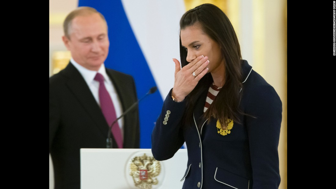 Yelena Isinbayeva is one of Russia's most famous athletes, but she won't be at the Rio Games. The polevaulter is barred from competing due to the blanket ban the IAAF placed on Russian track and field athletes. She wiped away a tear after giving a speech during a reception for the team hosted by President Putin.