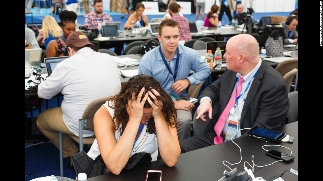 Journalists work inside a media tent outside the arena.