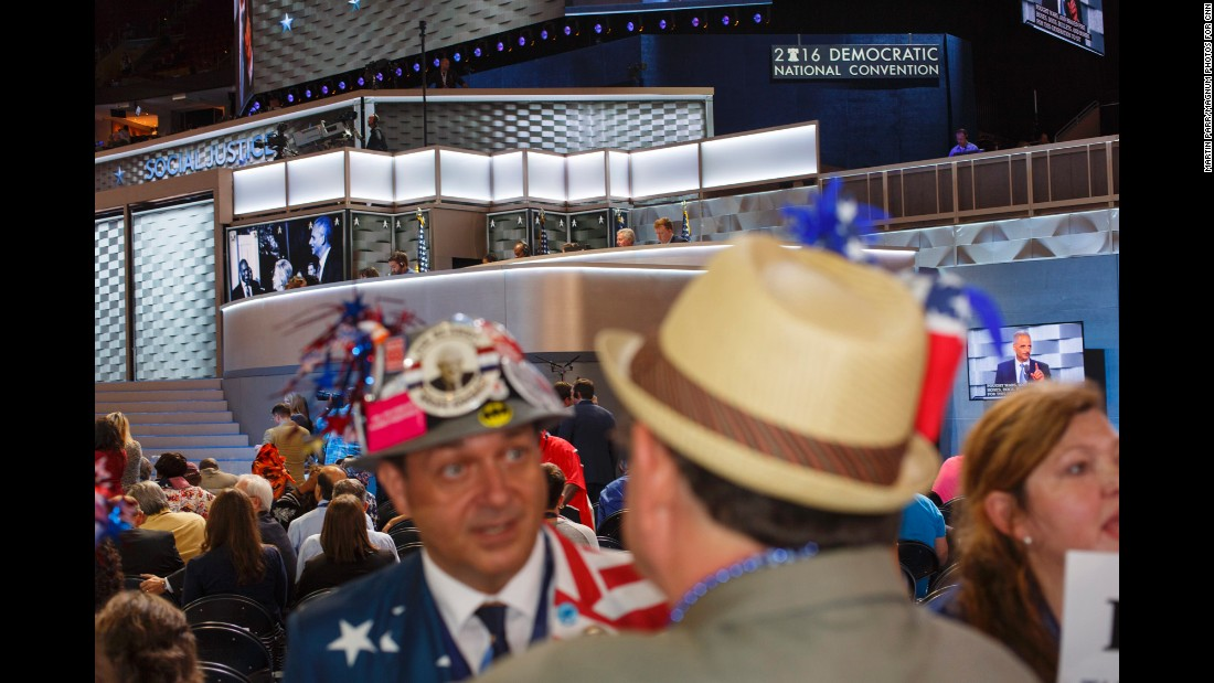 Media members work above the convention floor during a speech.