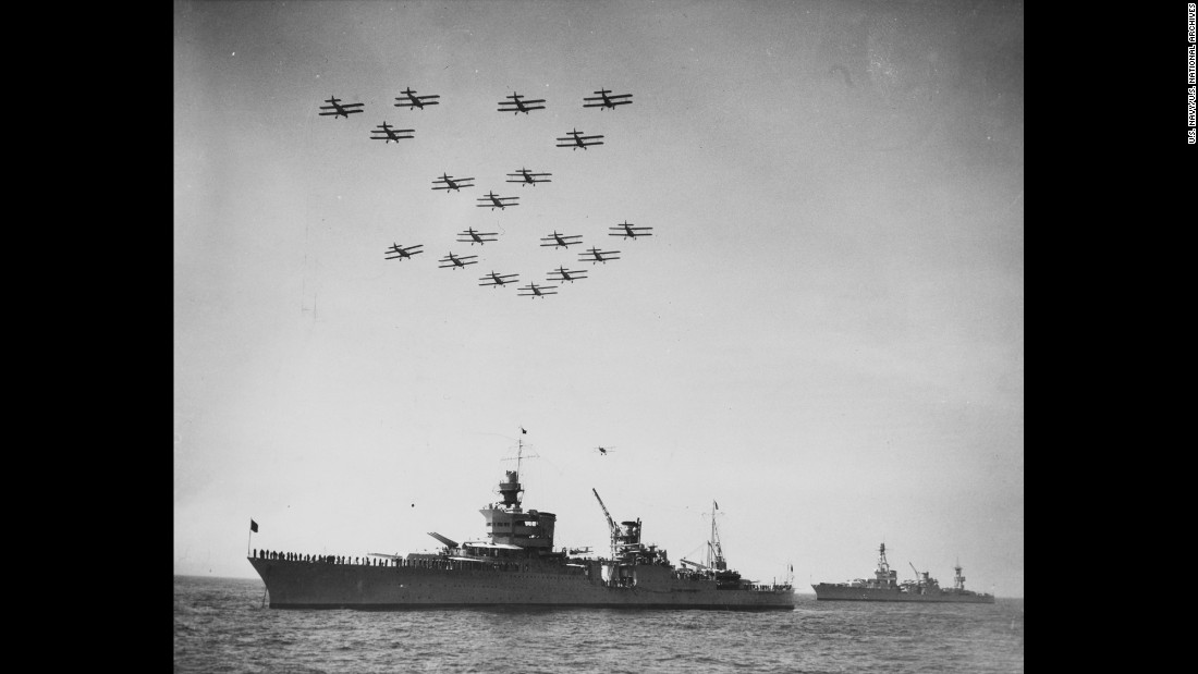 Torpedo planes pass over the cruiser during a fleet review off New York City in 1934. President Franklin D. Roosevelt was on the Indianapolis during the ceremony.