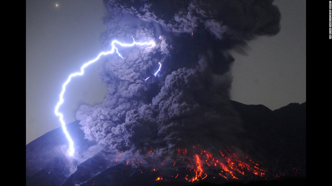 <strong>July 26:</strong> A thunderstorm occurs over Mount Sakurajima as the volcano erupts in Tarumizu, Japan.