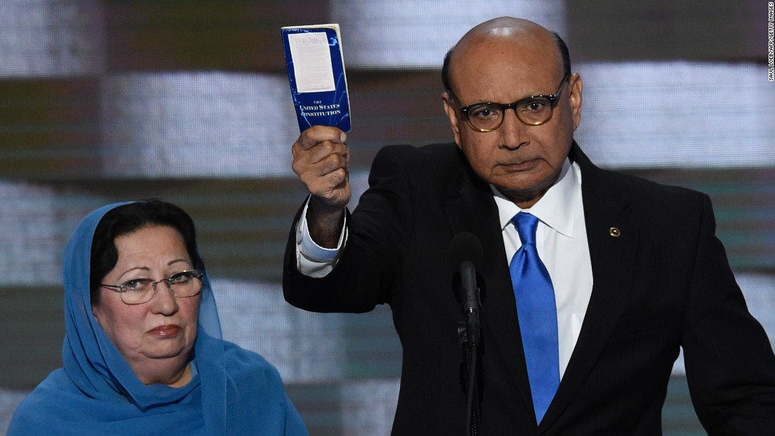 "Khizr Khan holds his personal copy of the U.S. Constitution as he speaks Thursday. His son, Humayun S. M. Khan, was one of the 14 American Muslims who have died serving their country since 9/11. In his remarks, Khan criticized the Republican nominee: ""If it was up to Donald Trump, (my son) never would have been in America. ... Donald Trump, you are asking Americans to trust you with our future. Let me ask you: Have you even read the U.S. Constitution? I will gladly lend you my copy."""