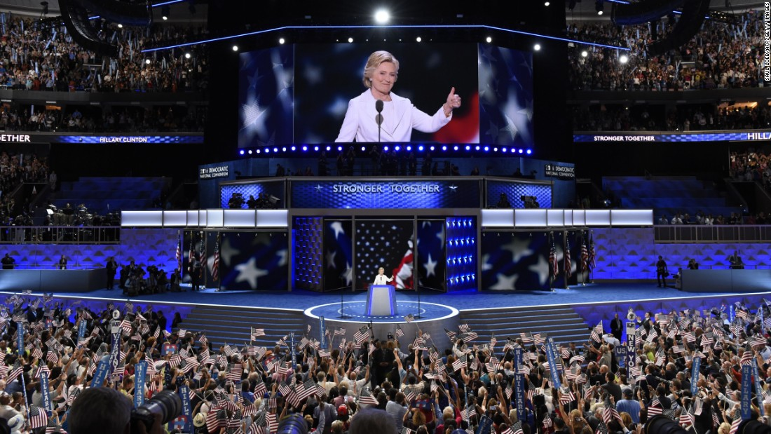 Clinton gives a thumbs-up to the crowd.