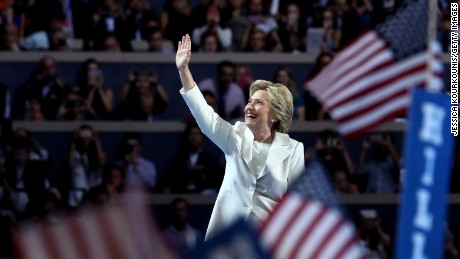 Democratic presidential candidate Hillary Clinton acknowledges the crowd as she arrives on stage during the fourth day of the Democratic National Convention at the Wells Fargo Center, July 28, 2016 in Philadelphia, Pennsylvania. Democratic presidential candidate Hillary Clinton received the number of votes needed to secure the party's nomination. An estimated 50,000 people are expected in Philadelphia, including hundreds of protesters and members of the media. The four-day Democratic National Convention kicked off July 25.