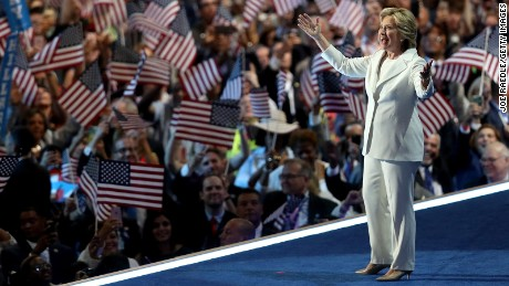 Hillary Clinton acknowledges the crowd as she arrives on stage during the fourth day of the Democratic National Convention at the Wells Fargo Center, July 28, 2016 in Philadelphia, Pennsylvania.
