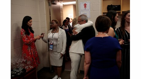 Backstage after accepting the presidential nomination, Clinton embraces campaign chairman John Podesta as another top aide, Huma Abedin, stands nearby.
