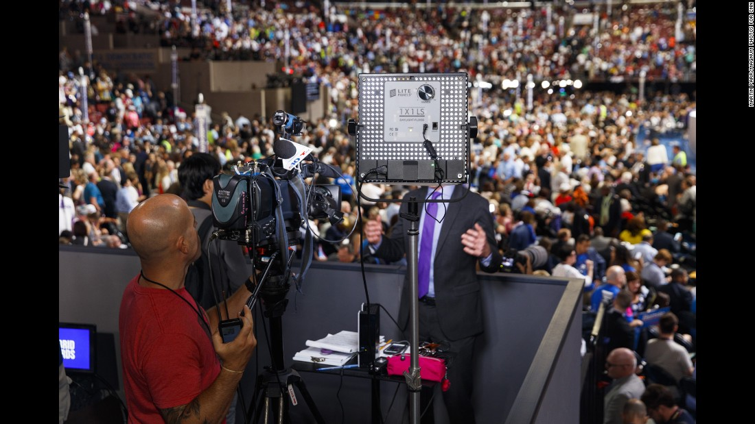 "NBC 10 Philadelphia broadcasts from a press stand above the floor of the Democratic National Convention. <a href=""http://www.cnn.com/2016/07/28/politics/cnnphotos-dnc-media-circus-martin-parr/index.html"" target=""_blank"">Photos: The 'media circus' at the DNC</a>"