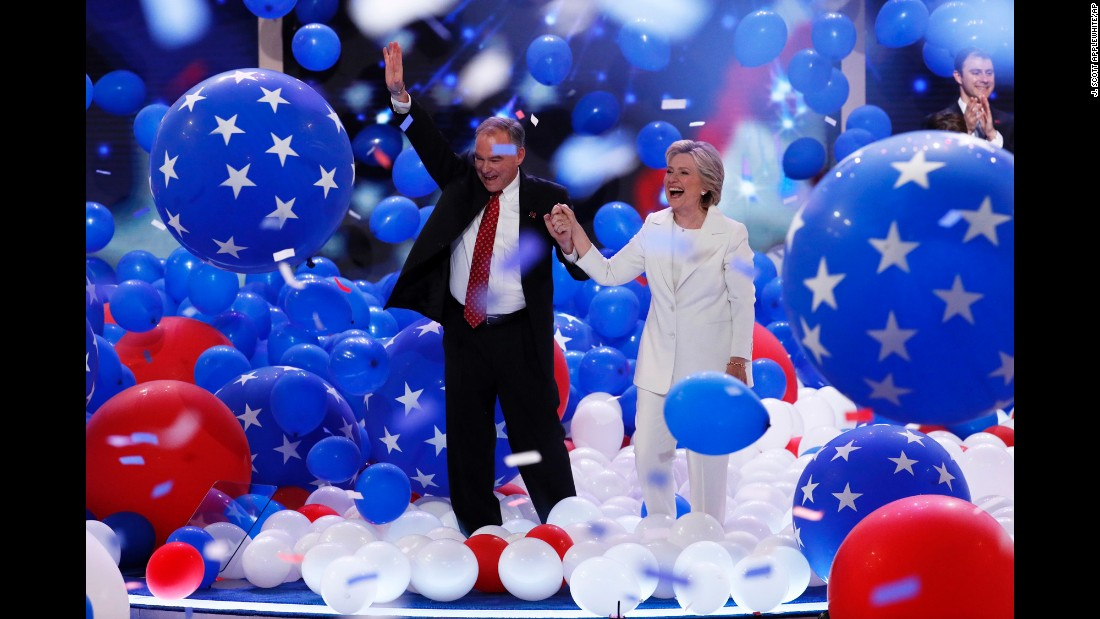 Democratic presidential nominee Hillary Clinton walks through balloons with her running mate, U.S. Sen. Tim Kaine, at the end of the Democratic National Convention on Thursday, July 28.