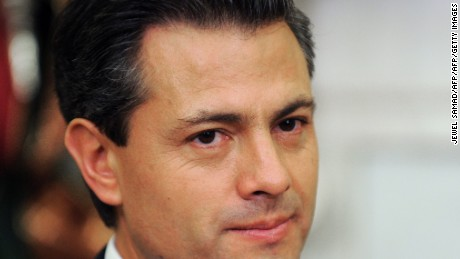 President-elect Enrique Pena Nieto of Mexico speaks during a bilateral meeting with US President Barack Obama in the Oval Office at the White House in Washington on November 27, 2012. Pena Nieto, a member of the Institutional Revolutionary Party (PRI), takes office on December 1, replacing Felipe Calderon from the conservative National Action Party (PAN), five months after his election victory.    AFP PHOTO/Jewel Samad        (Photo credit should read JEWEL SAMAD/AFP/Getty Images)