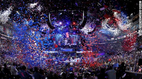 Balloons come down on Democratic presidential nominee Hillary Clinton and running mate Tim Kaine at the end of the fourth and final night of the Democratic National Convention at Wells Fargo Center on July 28, 2016 in Philadelphia, Pennsylvania.
