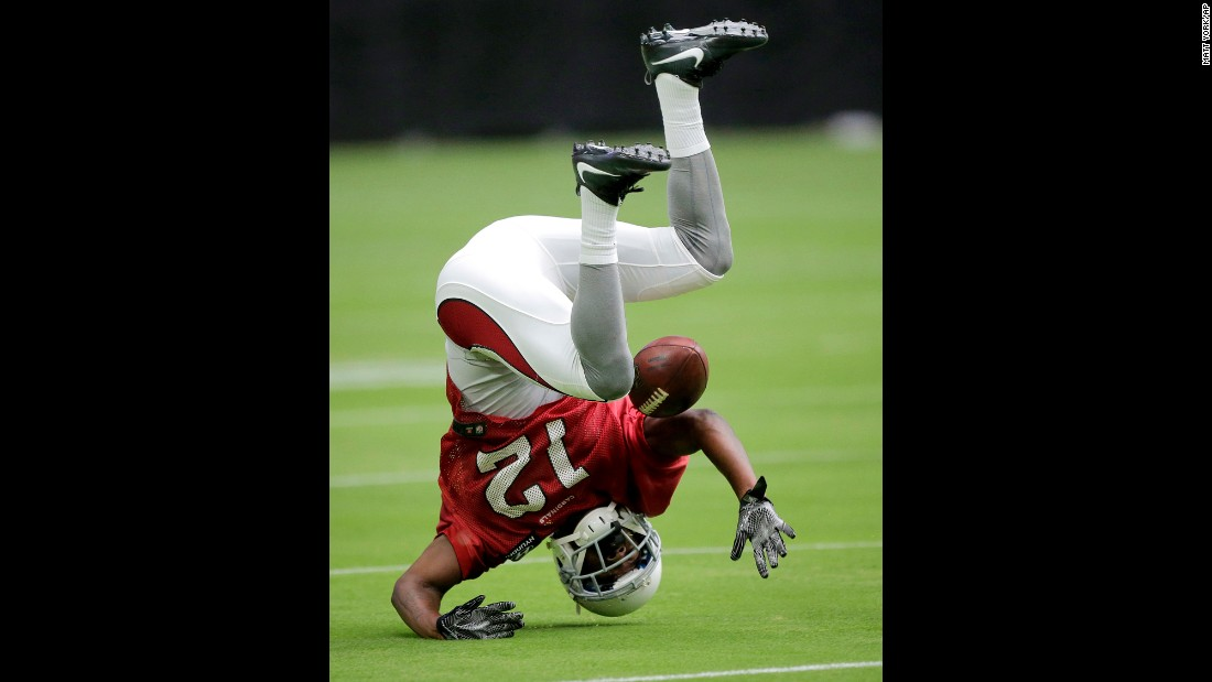 John Brown, wide receiver with the NFL's Arizona Cardinals, drops a ball during training-camp practice on Friday, July 29.