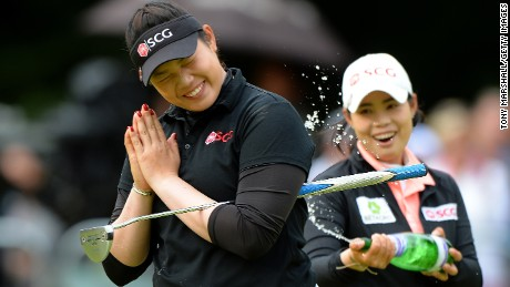 WOBURN, ENGLAND - JULY 31:  Ariya Jutanugarn of Thailand celebrates victory after holing the winning putt on the 18th green during the final round of the Ricoh Women's British Open at Woburn Golf Club on July 31, 2016 in Woburn, England.  (Photo by Tony Marshall/Getty Images)