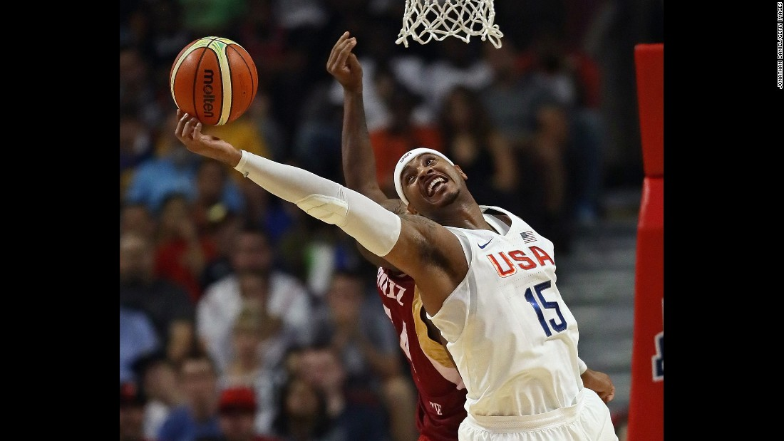 American basketball player Carmelo Anthony grabs a rebound against Venezuela during an Olympic tune-up in Chicago on Friday, July 29.