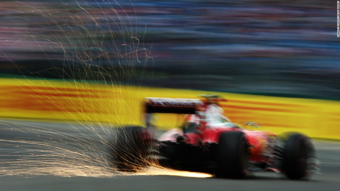Sparks fly from the car of Sebastian Vettel during practice for the German Grand Prix on Saturday, July 30.