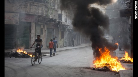 Residents burned tires and other materials to start fires in eastern Aleppo, to obscure the vision of pilots looking to drop bombs on neighborhoods.