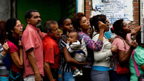 People queue up to buy food and basic household items in a supermarket at the Petare neighborhood in Caracas on July 16, 2016. The Venezuelan military began overseeing food distribution at ports, airports and businesses Tuesday as part of a plan by President Nicolas Maduro to alleviate acute shortages plaguing the country. / AFP PHOTO / FEDERICO PARRAFEDERICO PARRA/AFP/Getty Images