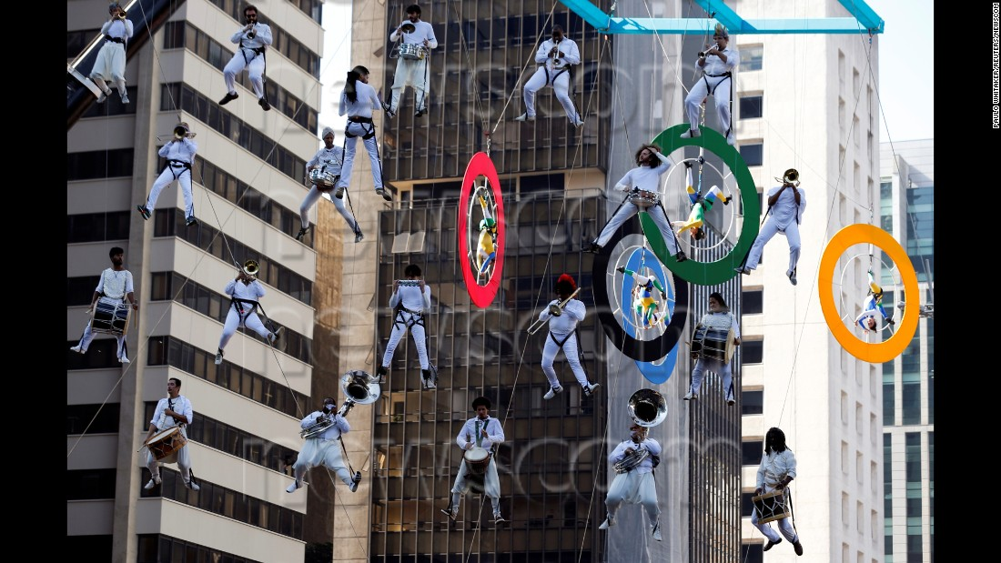Musicians perform in Sao Paulo during the Olympic torch relay on Sunday, July 24.