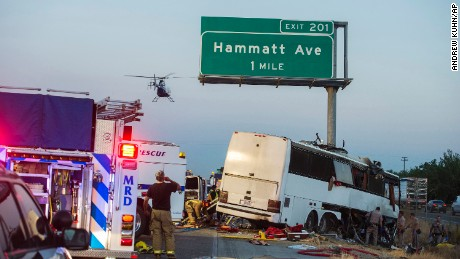 A charter bus veered off a central California freeway before dawn Tuesday and slammed into a pole.