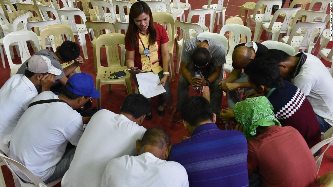 A social worker gives counseling to those who have turned themselves in for drug-related crimes in the Philippines on July 18, 2016.