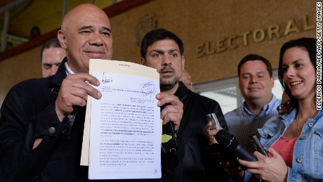 Venezuelan opposition spokesman Jesus Torrealba shows a document after delivering the application for the recall referendum at the CNE headquarters in Caracas, on August 2, 2016.  Venezuela's opposition gathered enough signatures to proceed with efforts to call a referendum on removing President Nicolas Maduro, electoral authorities confirmed, without setting a date for the next step. / AFP / FEDERICO PARRA        (Photo credit should read FEDERICO PARRA/AFP/Getty Images)