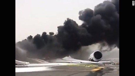 An Emirates flight en route from India appeared to catch fire after it made an emergency landing at Dubai International airport Wednesday, August 3, 2016.