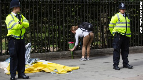 A woman lays flowers at the scene of the knife attack in London's Russell Square  on Thursday.